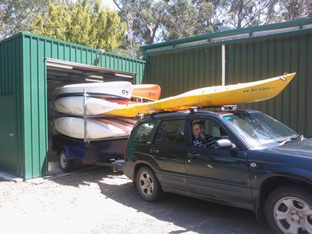 Simon backs the water craft trailer into the new storage space